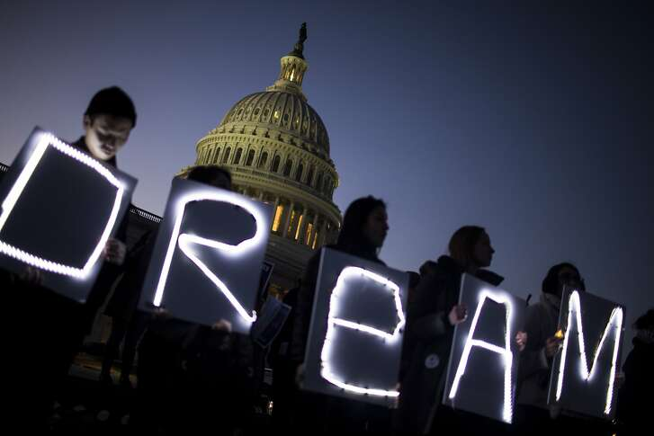 Demonstrators hold illuminated signs during a rally supporting the Deferred Action for Childhood Arrivals program (DACA), or the Dream Act, outside the U.S. Capitol building in Washington, D.C., U.S., on Thursday, Jan. 18, 2018. The House passed a spending�bill�Thursday to avoid a U.S. government shutdown, but Senate Democrats say they have the votes to block the measure in a bid to force Republicans and President�Donald Trump�to include protection for young immigrants. Photographer: Zach Gibson/Bloomberg