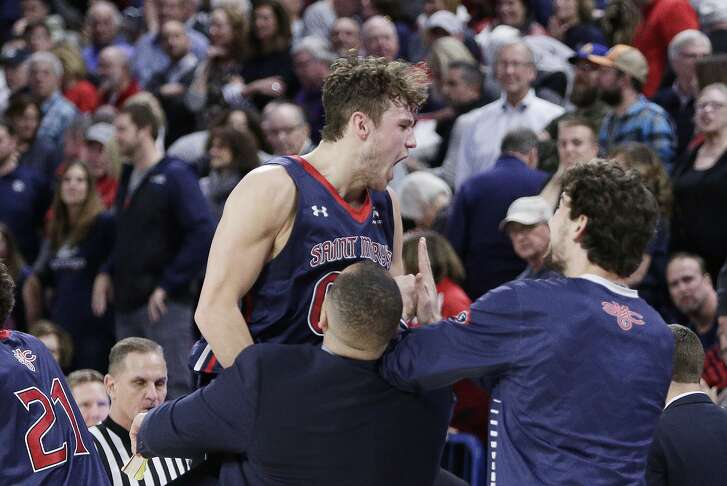 Saint Mary's guard Tanner Krebs, top, celebrates with his team after an NCAA college basketball game against Gonzaga in Spokane, Wash., Thursday, Jan. 18, 2018. Saint Mary's won 74-71. (AP Photo/Young Kwak)