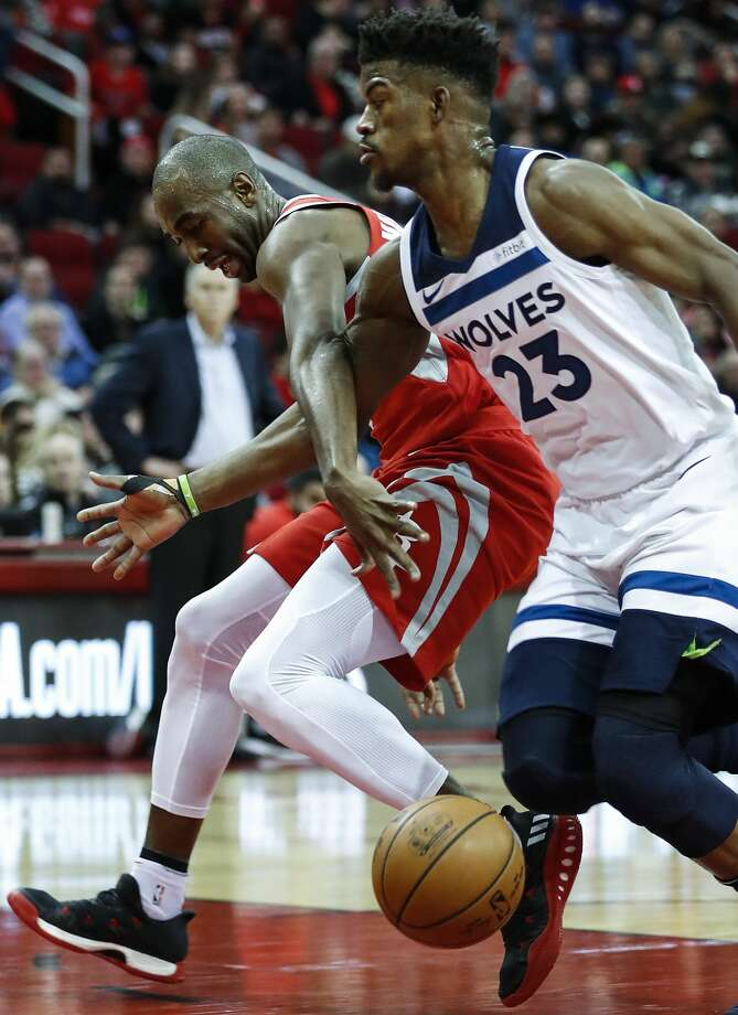 FILE-- Houston Rockets forward Luc Mbah a Moute (12) and Minnesota Timberwolves guard Jimmy Butler (23) fight for a loose ball during the first half of an NBA basketball game at Toyota Center on Thursday, Jan. 18, 2018, in Houston. Photo: Brett Coomer/Houston Chronicle