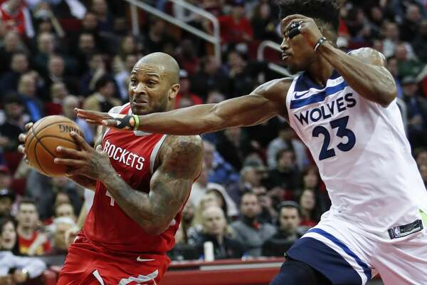 Houston Rockets forward PJ Tucker (4) runs past Minnesota Timberwolves guard Jimmy Butler (23) as he goes to the basket during the first half of an NBA basketball game at Toyota Center on Thursday, Jan. 18, 2018, in Houston. ( Brett Coomer / Houston Chronicle )