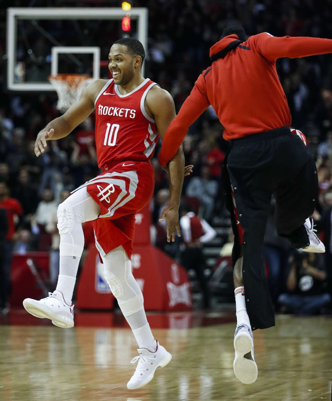 Houston Rockets guard Eric Gordon (10) and guard James Harden celebrate Gordon's last-second 3-pointer to end the third quarter against the Minnesota Timberwolves at Toyota Center on Thursday, Jan. 18, 2018, in Houston. ( Brett Coomer / Houston Chronicle )