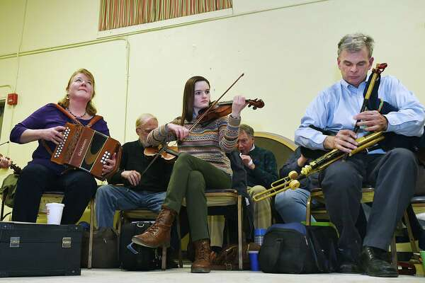 Loretta Egan Murphy, playing the button accordion, violinist Lindsey Ceitin and featuring uilleann piper Jerry O'Sullivan, master of the Irish bagpipe joins the P.V. O'Donnell branch of the Comhaltas Ceoltóirí Éireann for a session of Irish traditional music, Thursday, Jan. 18, 2018, at St. Gabriel's Parish Hall at 26 Broadway in Milford.