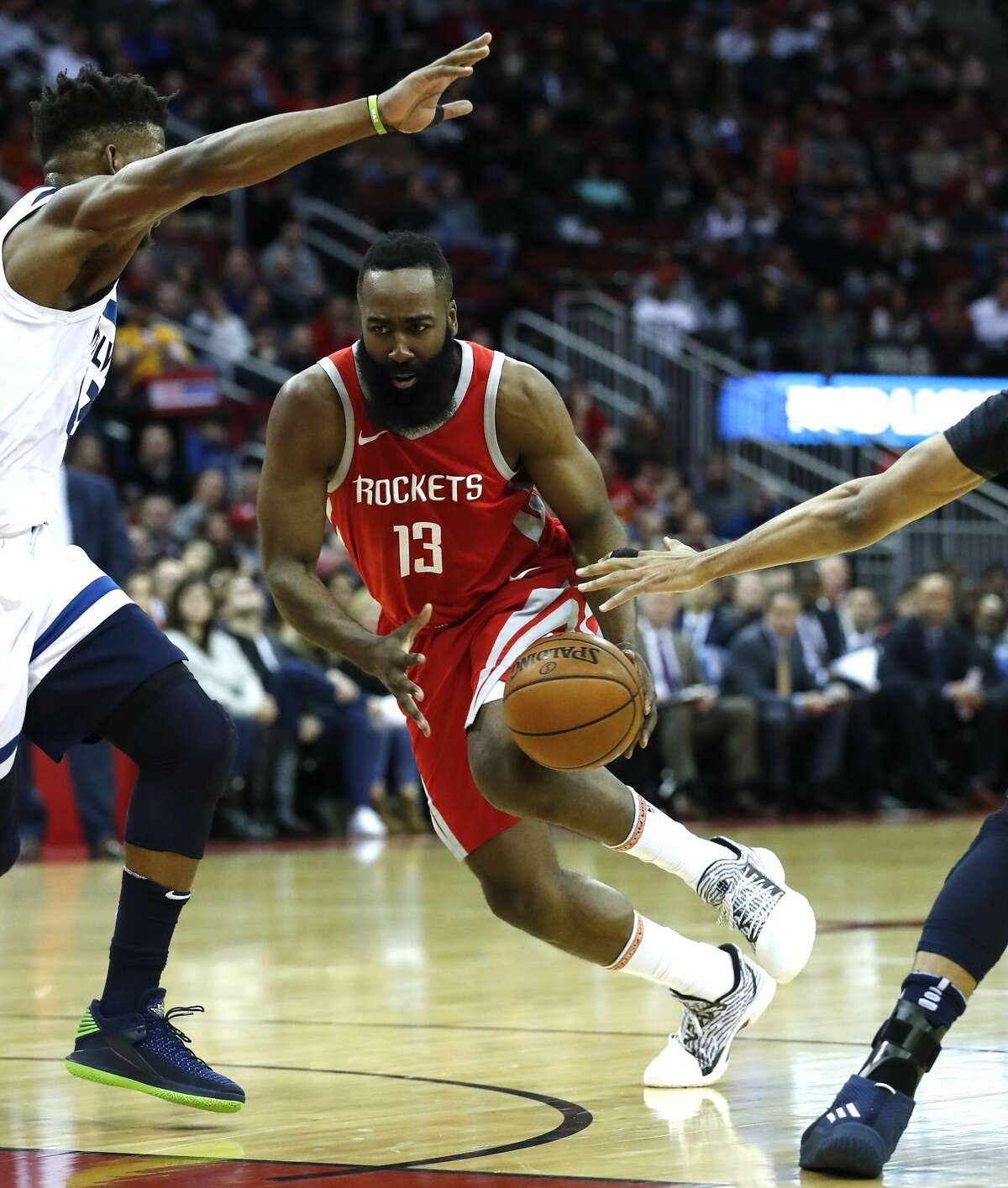 Houston Rockets guard James Harden (13) runs through a pair of defenders during the first half of an NBA basketball game against the Minnesota Timberwolves at Toyota Center on Thursday, Jan. 18, 2018, in Houston. ( Brett Coomer / Houston Chronicle )