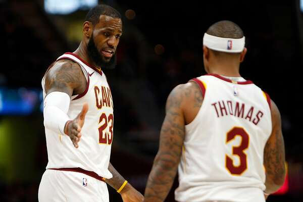CLEVELAND, OH - JANUARY 18:  LeBron James #23 of the Cleveland Cavaliers and Isaiah Thomas #3 of the Cleveland Cavaliers react to a foul against the Orlando Magic at Quicken Loans Arena on January 18, 2018 in Cleveland, Ohio. NOTE TO USER: User expressly acknowledges and agrees that, by downloading and or using this photograph, User is consenting to the terms and conditions of the Getty Images License Agreement. (Photo by Justin K. Aller/Getty Images)