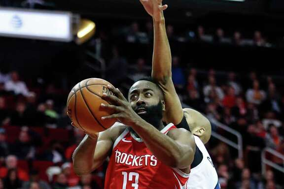 Houston Rockets guard James Harden (13) drives to the basekt past Minnesota Timberwolves forward Taj Gibson (67) during the first half of an NBA basketball game at Toyota Center on Thursday, Jan. 18, 2018, in Houston. ( Brett Coomer / Houston Chronicle )