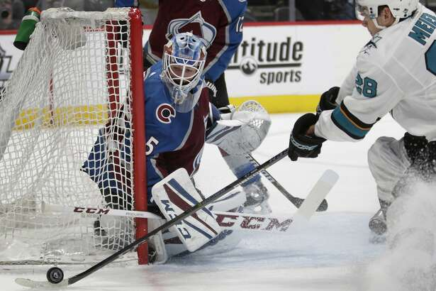 Colorado Avalanche goaltender Jonathan Bernier (45) watches as San Jose Sharks right wing Timo Meier (28) gathers the puck in the second period of an NHL hockey game in Denver on Thursday, Jan. 18, 2018. (AP Photo/Joe Mahoney)