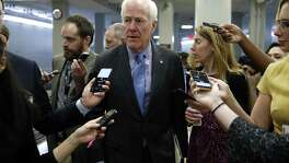 Sen. John Cornyn, R-Texas, speaks to reporters at the Capitol as Congress continued working to avoid a government shutdown.