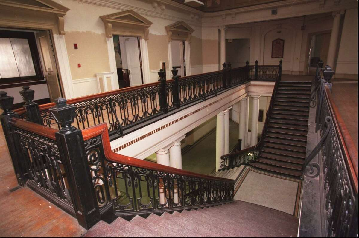 Stamford officials are considering a new use for the Old Town Hall at Atlantic and Main streets. This view is from the second floor looking down the main staircase on Jan. 22, 1996.