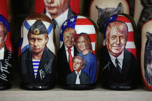 Souvenir matryoshka dolls depicting Vladimir Putin, Russia's president, left, and President Donald Trump and his family sit on display at a tourist stall in the city center ahead of the St. Petersburg International Economic Forum in Saint Petersburg, Russia, on May 31, 2017. Photograph