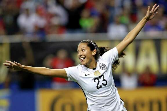 United States' Christen Press (23) celebrates after scoring a goal against Trinidad & Tobago during second half action of their international friendly soccer match Thursday Dec. 10, 2015 at the Alamodome. The United States won 6-0.