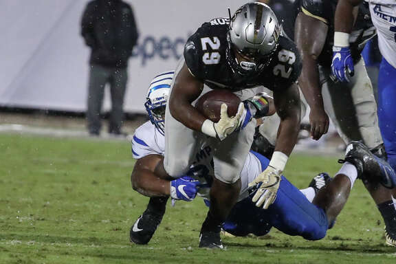 ORLANDO, FL - SEPTEMBER 30: DUPLICATE***UCF Knights running back Cordarrian Richardson (29) is tackled during the football game between the UCF Knights and the Memphis Tigers on September 30, 2017 at Spectrum Stadium in Orlando FL. (Photo by Joe Petro/Icon Sportswire via Getty Images)
