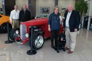 Tommie Vaughn Ford is a three-generation, dog-friendly auto business with Jim and Jeanie Janke's sons Kyle, far left, and Kirby overseeing parts, service, finance and sales at the well-known dealership on North Shepherd. Other pack members include Labrador retriever Hunter and Maisy, a Jack Russell terrier.