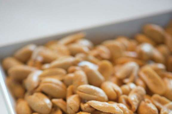 Shelled, roasted peanuts are a nutritious snack. The plants are easy to grow at home.