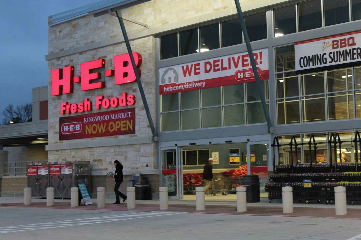 Customers enter the Kingwood H-E-B early in the morning on Friday, Jan. 19, which was the store's grand re-opening day after a five-month closure due to flood damage from Hurricane Harvey.