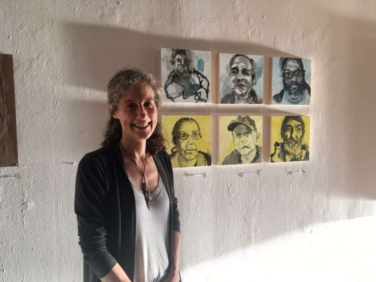 """The art exhibition, """"Portraits of a Community,"""" is a collection of original works by Abby Carter."""