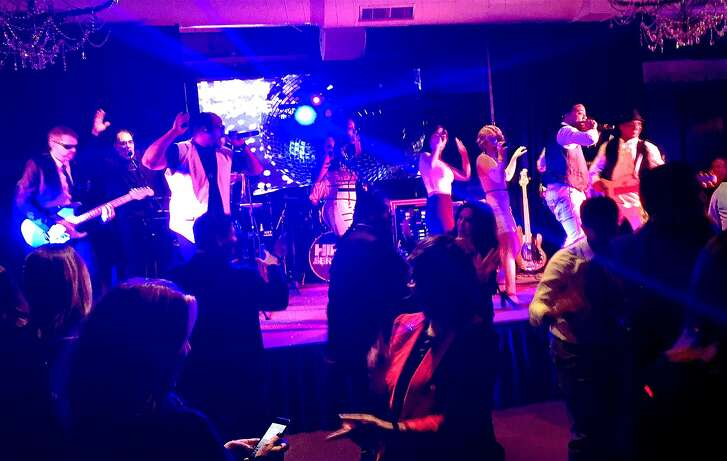 Revelers dance to live music at the Back to Session Bash in Sacramento.