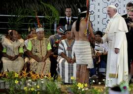 "Pope Francis greets an indigenous representative in Puerto Maldonado, Peru, Friday, Jan. 19, 2018. Standing with thousands of indigenous Peruvians, Francis declared the Amazon the ""heart of the church"" and called for a three-fold defense of its life, land and cultures. (AP Photo/Alessandra Tarantino)"