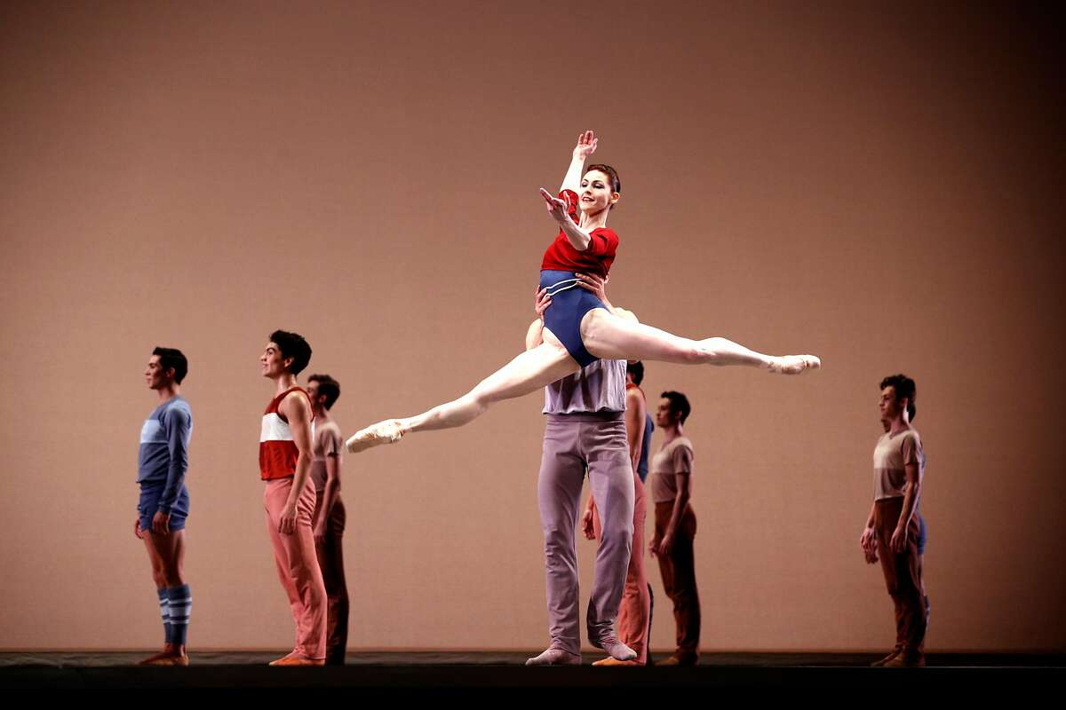 """Dancers join principals Sofiane Syle and Carlo Di Lanno as they perform """"Rodeo"""" during a dress rehearsal for San Francisco Ballet 's opening night gala at the War Memorial Opera House on Thursday, Jan. 18, 2018 in San Francisco, Calif."""