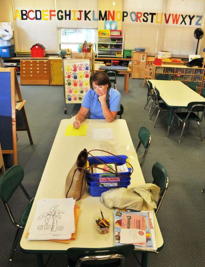 Full-day kindergarten can be a long day for a five-year-old, but a welcoming classroom like the one prepared by Pat Clement at Slingerlands Elementary School can help ease the transition. Photo: John Carl D'Annibale / 00005371A