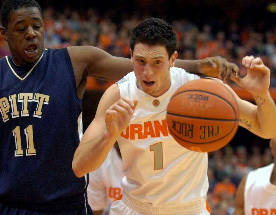 Syracuse's Andy Rautins, right, battles Pittsburgh's Dante Taylor for a loose ball. (AP Photo/Kevin Rivoli) Photo: Kevin Rivoli