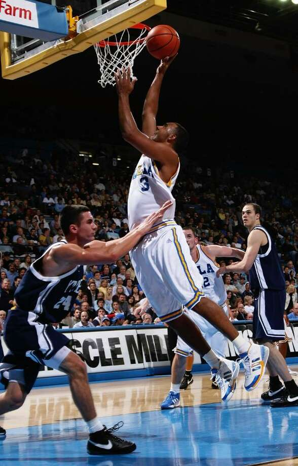 UCLA's Josh Shipp shoots over Yale's Alex Zampier on Nov. 23, 2007, at Pauley Pavillion in Westwood, Calif.  (Stephen Dunn/Getty Images) Photo: Stephen Dunn / 2007 Getty Images