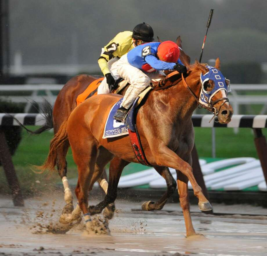 Travers Stakes winner Summer Bird, with jockey Kent Desormeaux aboard, outduels Quality Road, with jockey John Velazquez, by a length in the sloppy Jockey Club Gold Cup at Belmont Park. (Skip Dickstein / Times Union) Photo: SKIP DICKSTEIN