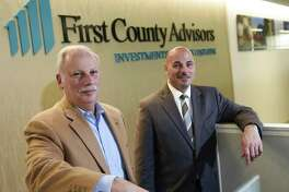 First County Bank Chairman and CEO Rey Giallongo, left, and SVP of Retail Banking Willard Miley pose at the First County Bank executive offices in Stamford, Conn. Thursday, Dec. 21, 2017. The bank recently implemented the use of prize-linked savings accounts, which are gaining traction around the U.S.