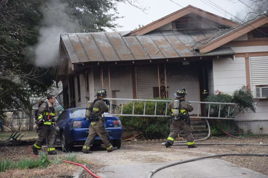 A space heater is believed to have caused an East Side house fire that displaced four people on Friday. Photo: Caleb Downs / San Antonio Express-News