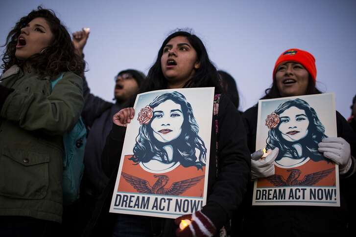 Demonstrators sing and hold signs during a rally supporting the Deferred Action for Childhood Arrivals program (DACA), or the Dream Act, outside the U.S. Capitol building in Washington, D.C., U.S., on Thursday, Jan. 18, 2018. The House passed a spending�bill�Thursday to avoid a U.S. government shutdown, but Senate Democrats say they have the votes to block the measure in a bid to force Republicans and President�Donald Trump�to include protection for young immigrants. Photographer: Zach Gibson/Bloomberg