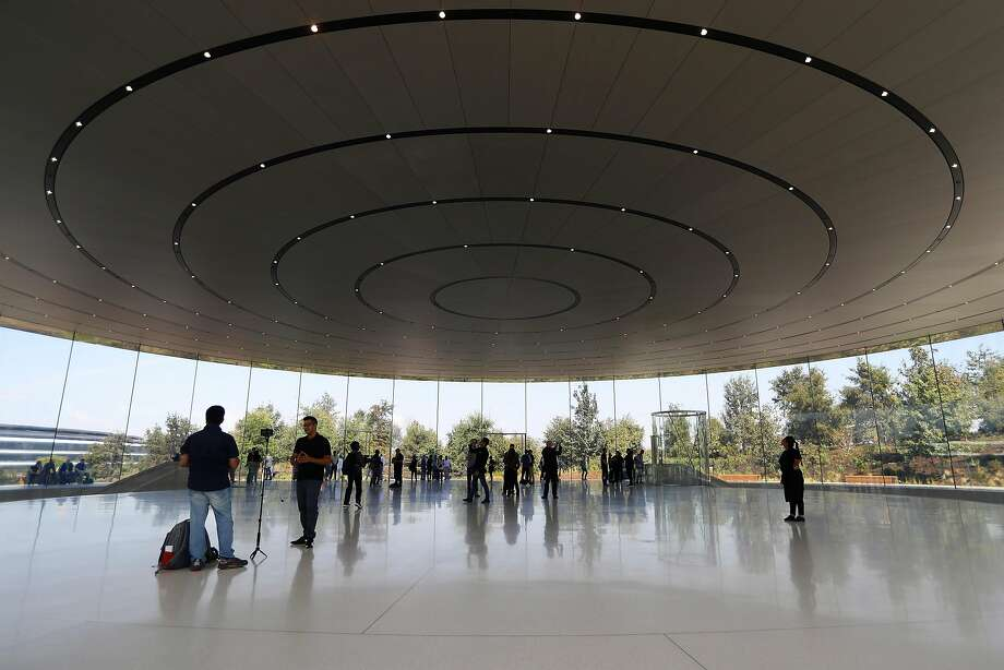 A building at Apple's new campus in Cupertino. The company this week forecast that its contributions to the U.S. economy would amount to more than $350 billion over the next five years. Photo: JIM WILSON, NYT