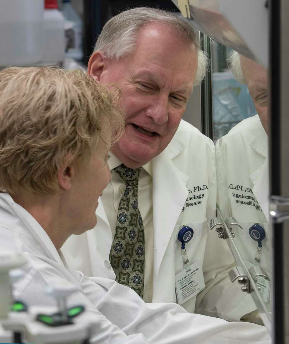 Researchers Dennis Metzger, PhD., Professor and Chair of the Immunology Microbial Disease Department and Sharon Salmon, lab manager work together Friday Jan 18, 2018 at Albany Medical College in Albany, N.Y. (Skip Dickstein/Times Union)