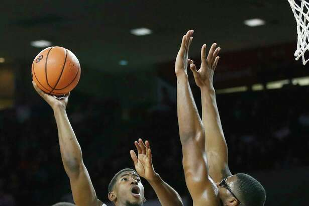 Oklahoma guard Christian James (0) shoots between Northwestern State guard Jalan West (12), forward Ishmael Lane (20) and forward Brandon Hutton, right, in the second half of an NCAA college basketball game in Norman, Okla., Tuesday, Dec. 19, 2017. Oklahoma won 105-68. (AP Photo/Sue Ogrocki)