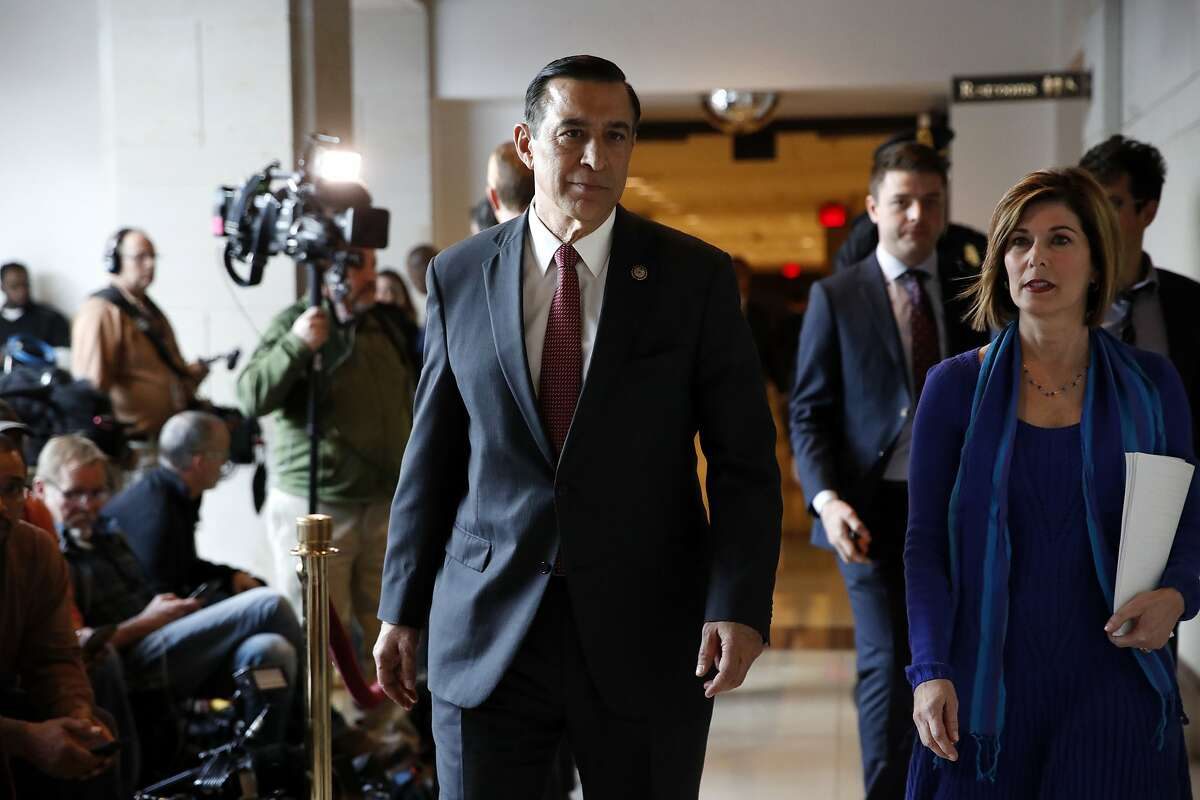 Rep. Darrell Issa, R-Calif., center, walks past members of the media on Capitol Hill, Tuesday, Jan. 16, 2018, in Washington. (AP Photo/Jacquelyn Martin)