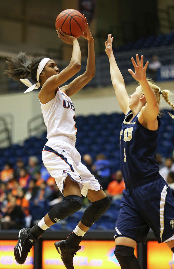 Crystal Chidomere hangs for a jumper against Zsofia Labady as UTSA women host Florida International University in the UTSA Convocation Center on February 5, 2015. Photo: Tom Reel