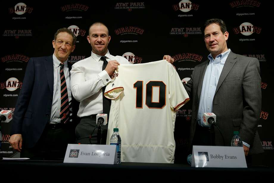 From left: San Francisco Giants CEO Larry Baer, Evan Longoria and general manager Bobby Evans during a news conference at AT&T Park, Friday, Jan. 19, 2018, in San Francisco, Calif. The S.F. Giants introduced Longoria as their new third baseman. Photo: Santiago Mejia, The Chronicle