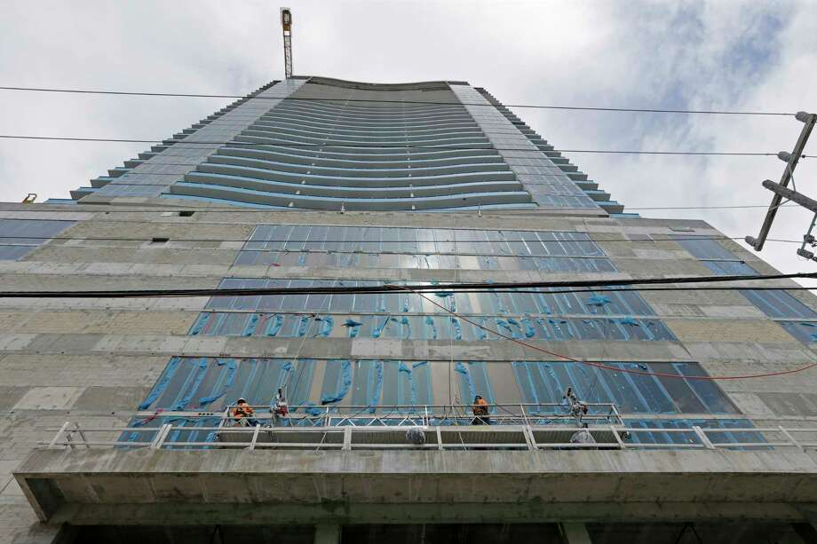 In this Monday, Oct. 2, 2017, photo, construction continues on a high-rise condominium project in Miami. On Thursday, Jan. 18, 2018, the Commerce Department reports on U.S. home construction in December. (AP Photo/Alan Diaz) Photo: Alan Diaz / Copyright 2017 The Associated Press. All rights reserved.