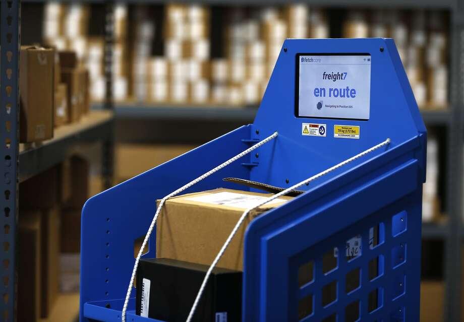 An autonomous mobile robot navigates through the Fetch Robotics testing warehouse in San Jose. Photo: Paul Chinn, The Chronicle