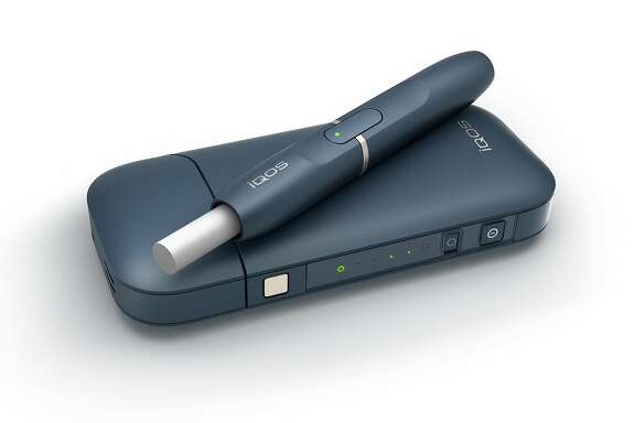 This undated image provided by Philip Morris in January 2018 shows the company's iQOS product. The device heats tobacco sticks but stops short of burning them, an approach that Philip Morris says reduces exposure to tar and other toxic byproducts of burning cigarettes. This is different from e-cigarettes, which don't use tobacco at all but instead vaporize liquid usually containing nicotine. (Philip Morris via AP)