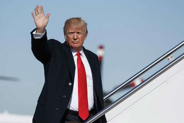 President Donald Trump waves as he boards Air Force One, Thursday, Jan. 18, 2018, in Andrews Air Force Base, Md. (AP Photo/Evan Vucci)