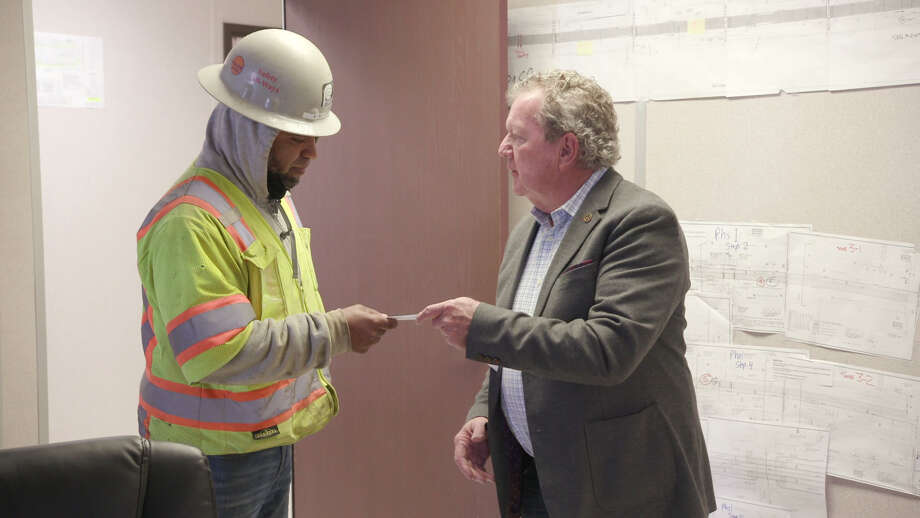 National construction group distributes checks to workers for America s best contractors