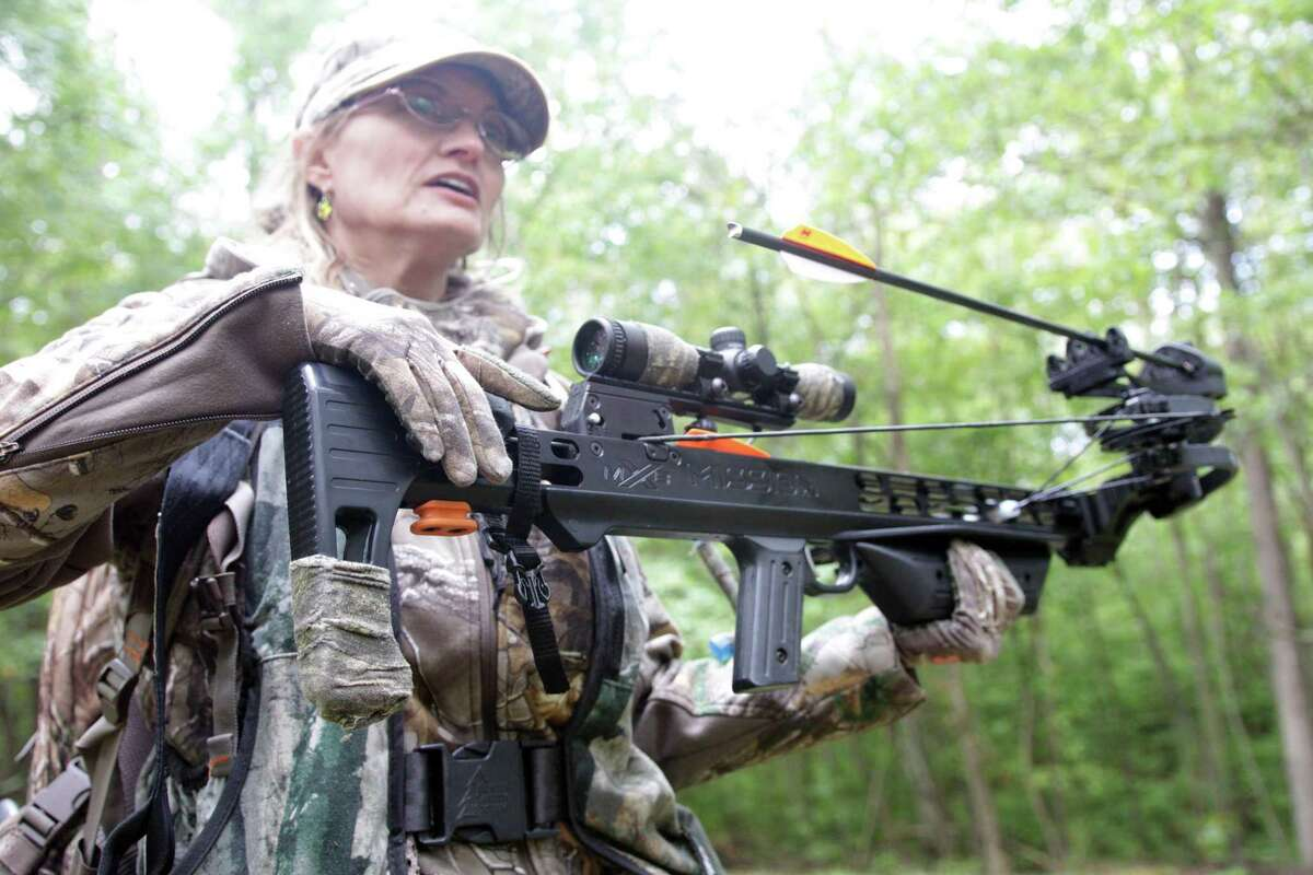Aili McKeen, a volunteer Department of Energy and Environmental Protection senior conservation education instructor, near Madison, Conn., where she hunts white-tailed deer with a crossbow.