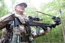 Aili McKeen, a volunteer DEEP Senior Conservation Education Instructor, near Madison, Conn. where she hunts white-tailed deer with a crossbow.