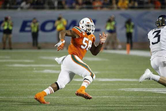 ORLANDO, FL - DECEMBER 28: Darrion Owens #58 of the Miami Hurricanes in action during the Russell Athletic Bowl against the West Virginia Mountaineers at Camping World Stadium on December 28, 2016 in Orlando, Florida. Miami defeated West Virginia 31-14. (Photo by Joe Robbins/Getty Images)