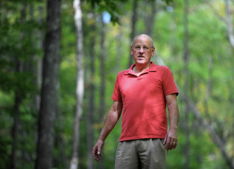 John Carr, of Bridgewater, walks around his 24-acre property in Bridgewater, Conn., Wednesday, Oct. 8, 2014. Carr has fought for 17 years to build a 100 unit residential development on the land on Route 133 in Bridgewater. Photo: Autumn Driscoll / Autumn Driscoll / Connecticut Post