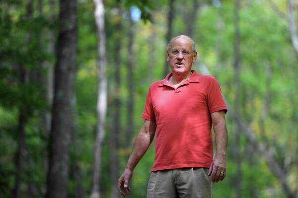 John Carr, of Bridgewater, walks around his 24-acre property in Bridgewater, Conn., Wednesday, Oct. 8, 2014. Carr has fought for 17 years to build a 100 unit residential development on the land on Route 133 in Bridgewater.