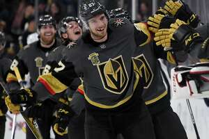 LAS VEGAS, NV - DECEMBER 19:  Shea Theodore #27 of the Vegas Golden Knights celebrates with teammates after scoring on a power-play goal with 2.3 seconds left in the third period to beat the Tampa Bay Lightning 4-3 at T-Mobile Arena on December 19, 2017 in Las Vegas, Nevada.  (Photo by Ethan Miller/Getty Images)