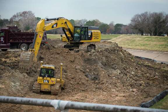 An excavator works on an area along Brays Bayou just outside the 610 Loop in the Meyerland area, Thursday, Jan. 18, 2018, in Houston. ( Mark Mulligan / Houston Chronicle )
