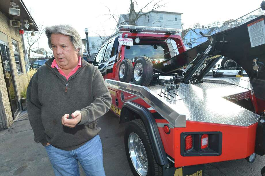 Fedor Auto Body Works owner Allen Fedor stands in front of one of their new tow trucks at the business on Nov. 27, 2017, in Norwalk. Photo: Alex Von Kleydorff / Hearst Connecticut Media / Norwalk Hour