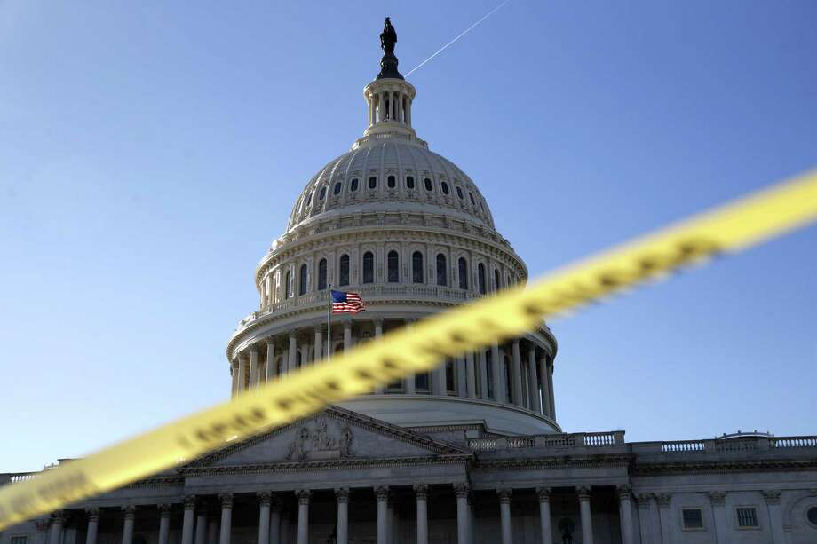 Police tape marks a secured area of the Capitol, Friday, Jan. 19, 2018, in Washington, as a bitterly-divided Congress hurtles toward a government shutdown this weekend. Photo: Jacquelyn Martin / Associated Press / Copyright 2018 The Associated Press. All rights reserved.
