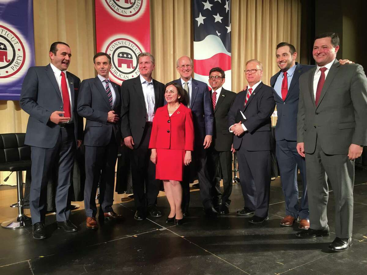 Republican candidates gathered after their Jan. 10 debate in Hebron. From left, Peter Lumaj, Mike Handler, Steve Obsitnik, Toni Boucher, Dave Walker, Prasad Srinivasan, Mark Boughton, party chairman J.R. Romano and Tim Herbst. Not pictured but a the debate was Mark Lauretti.